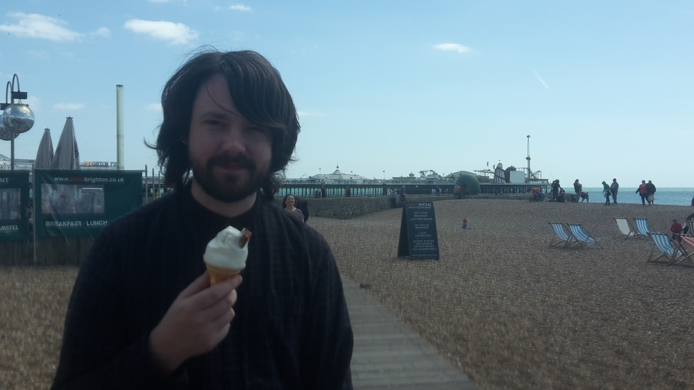 Dan eating ice cream on Brighton beach