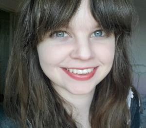 Wearing Cynthia Rowley Beauty Creamy Lip Stain in Poppy