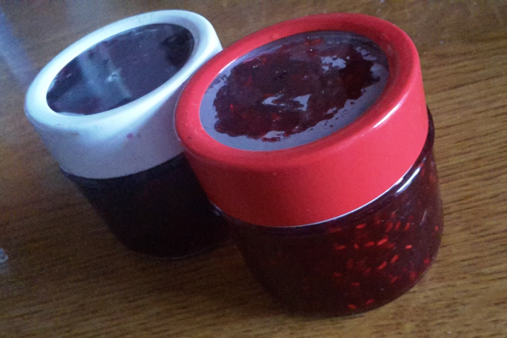Two jars of homemade blackberry and raspberry jam