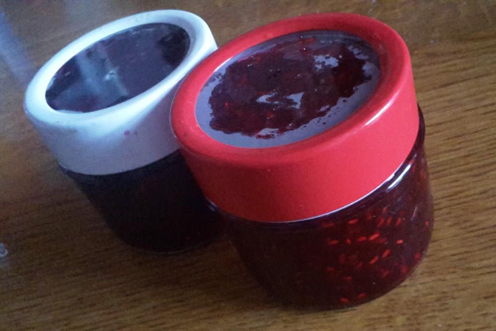 Two jars of homemade blackberry and raspberry jam