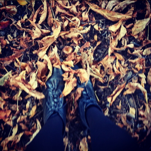 Boots in autumn leaves in Brighton