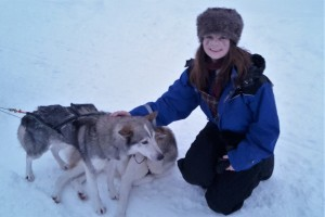 Kayleigh Tanner with two huskies in Finnish Lapland