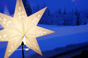 Christmas light against a snowy background in Lapland