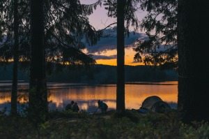 Camping next to a lake at sunset