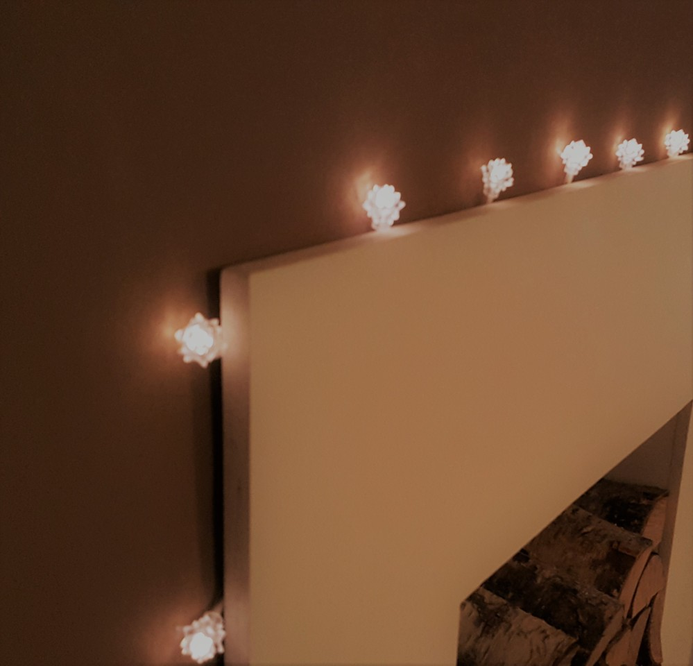 Fairy lights around the fireplace